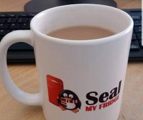 Seal My Fridge logo on the coffee cup